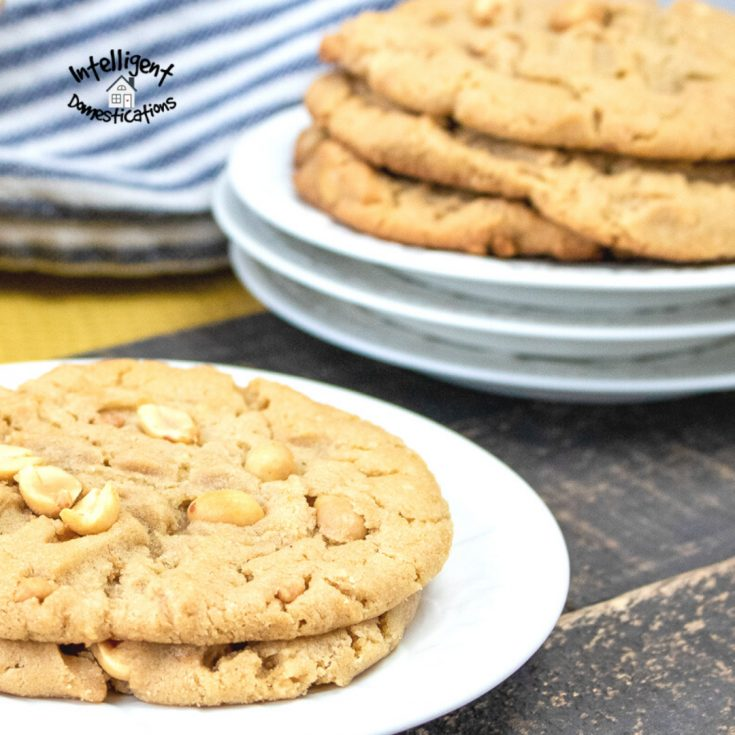 Peanut Butter cookies stacked on top of one another on a white dish