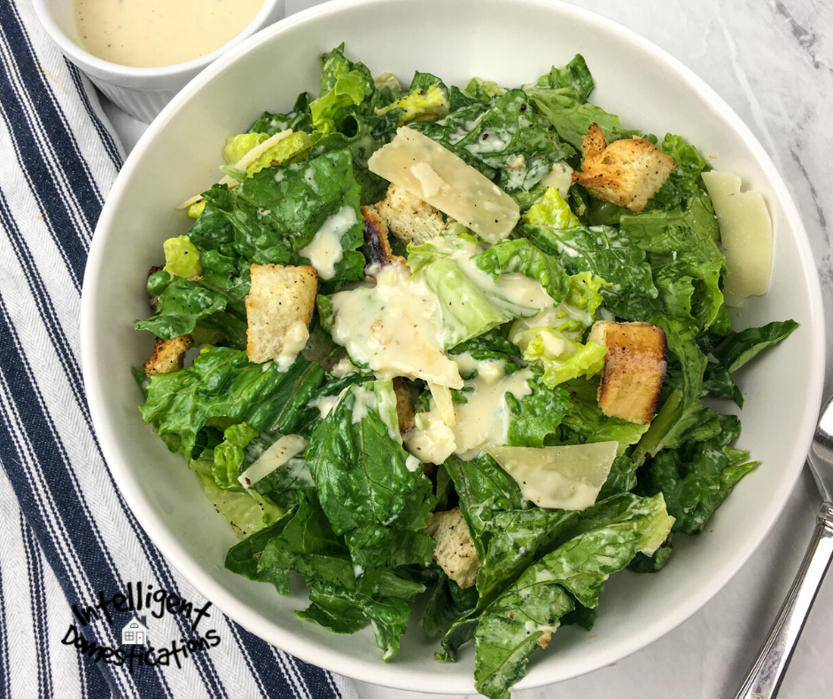A white bowl of Caesar Salad