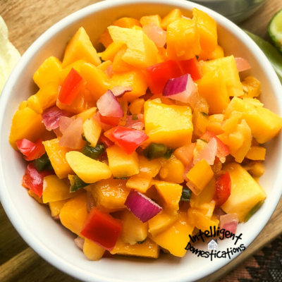 a white bowl of fresh mango salsa