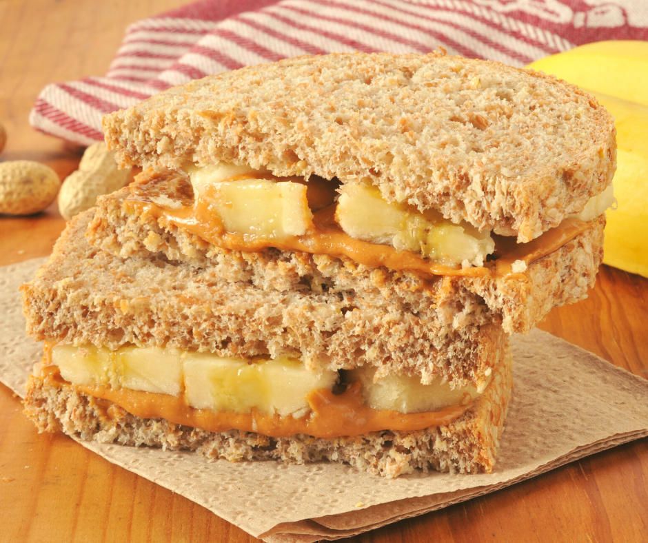 A peanut butter and banana sandwich sliced in half