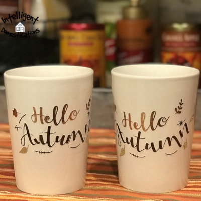 White coffee mugs with a Fall saying in front of a Coffee bar on a kitchen counter