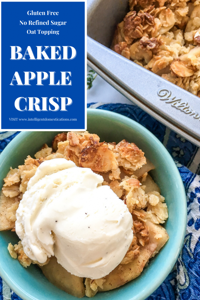 Baked Apple Crisp in a bowl with ice cream on top sitting next to a baking pan with Baked Apple Crisp