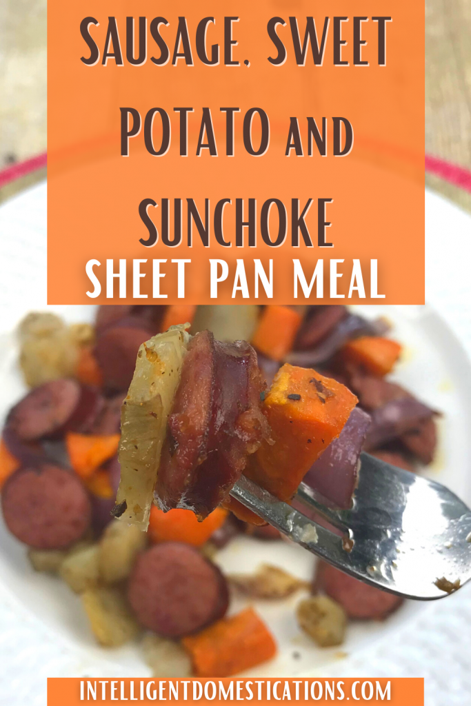Roasted Smoked sausage with yams and sunchokes on a white dish