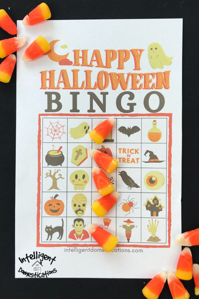 A Halloween BINGO card with candy corn on it