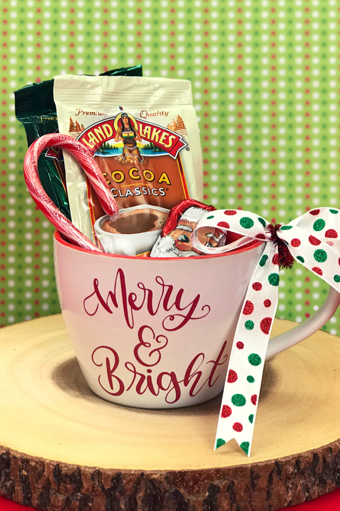 A Merry & Bright theme Christmas mug gift with cocoa and candy tucked inside