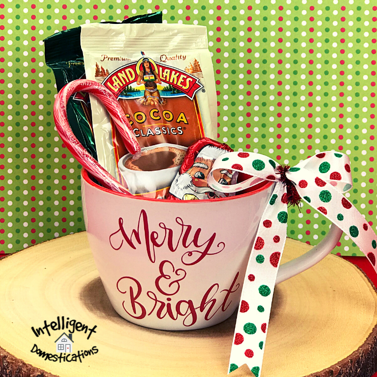 Christmas Gift Elf Cam Mug filled with cocoa and  goodiesgoodies