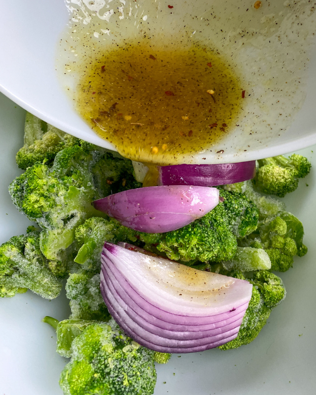 broccoli and red onion with a sauce