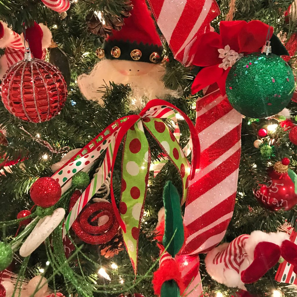 Ribbon bow and ornaments on a Christmas tree