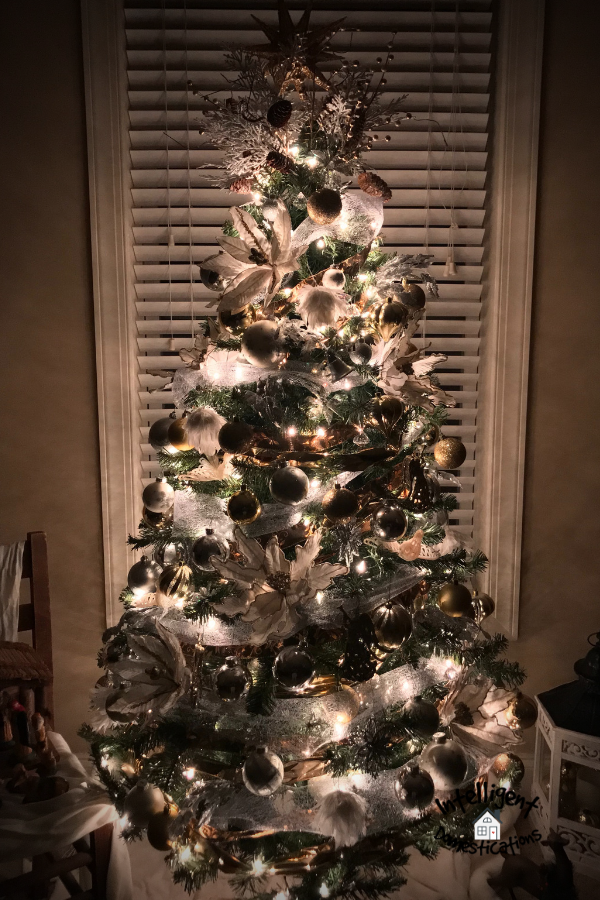 Silver and Gold decorated Christmas tree lit up at night