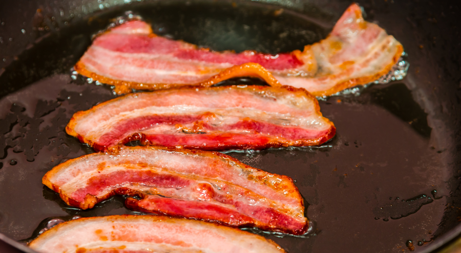 Bacon frying in a skillet