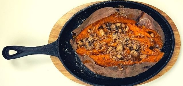 baked sweet potato stuffed with butter and crushed chocolate chip cookies