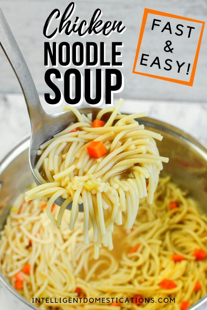 a pot full of chicken noodle soup