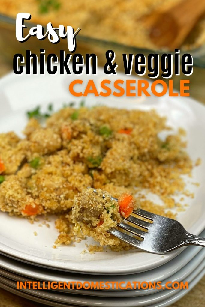chicken casserole with peas and carrots on a white dish