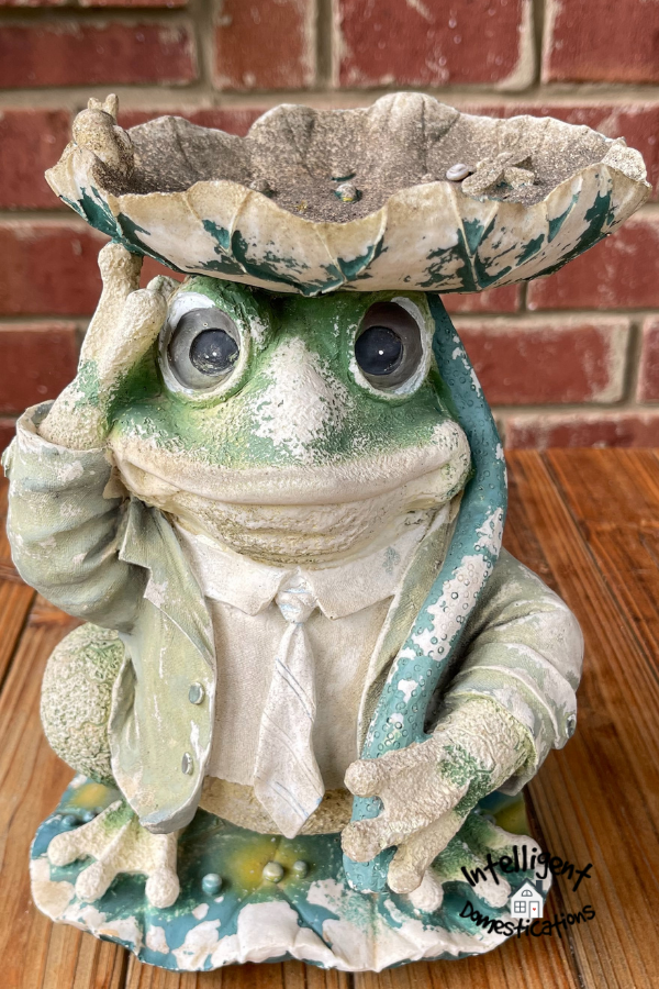 Faded Resin frog porch stature in need of new paint