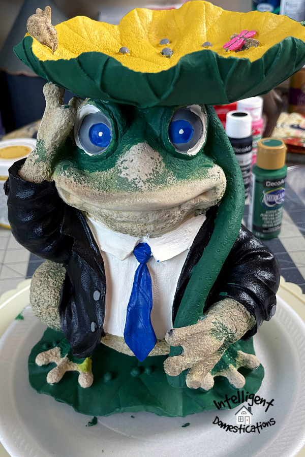 Frog statue partially painted